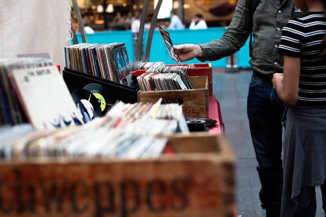 Two people looking through crates of records