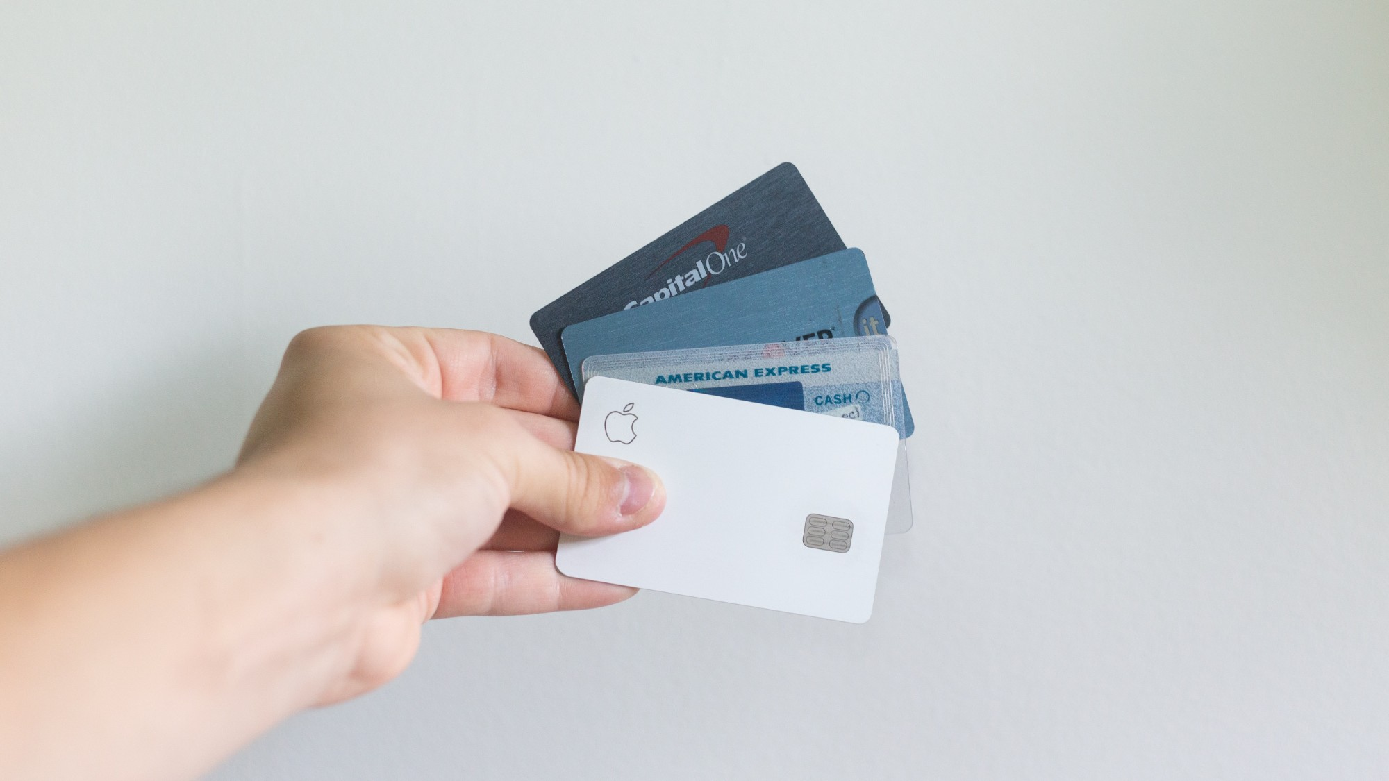 Hand holding multiple credit cards