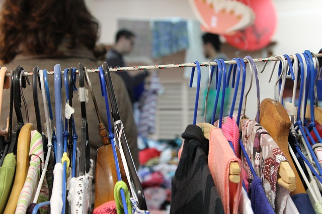 Clothes on hangers on display at a thrift store