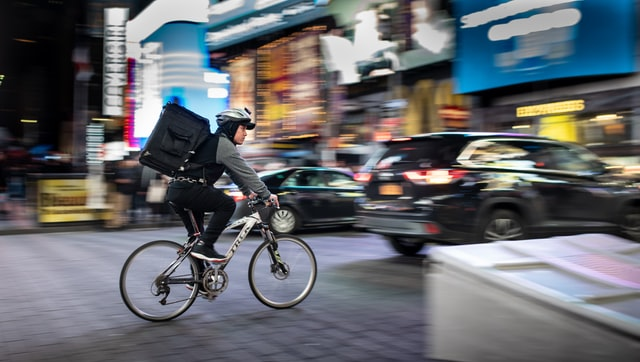 Bike delivery rider in traffic
