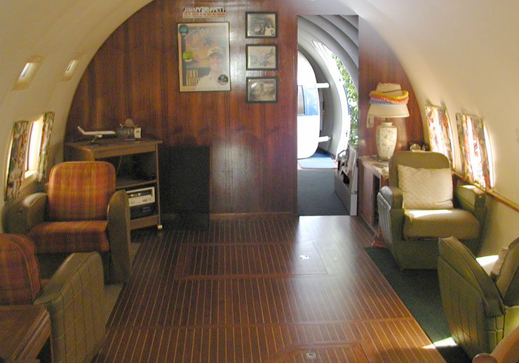 The interior of the plane boat, with several nice chairs, similar to a luxury plane cockpit