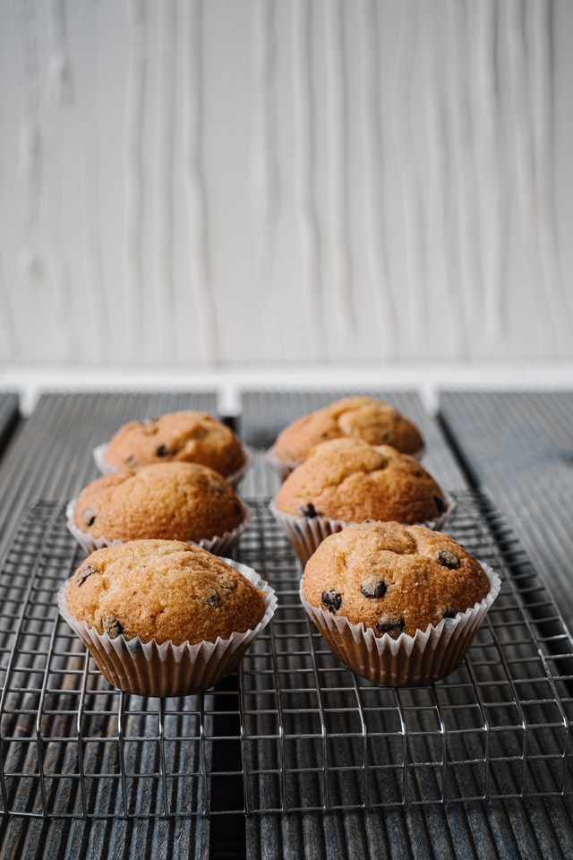 Homemade muffins on cooling rack