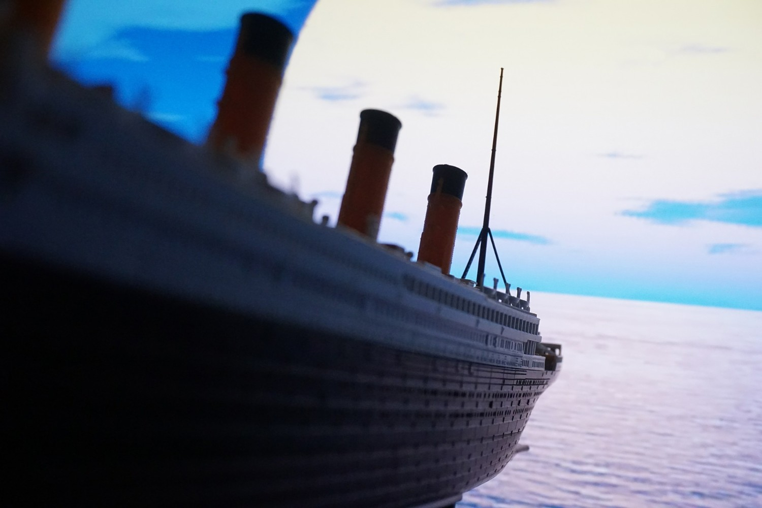 Close up of Titanic model, with ocean in background