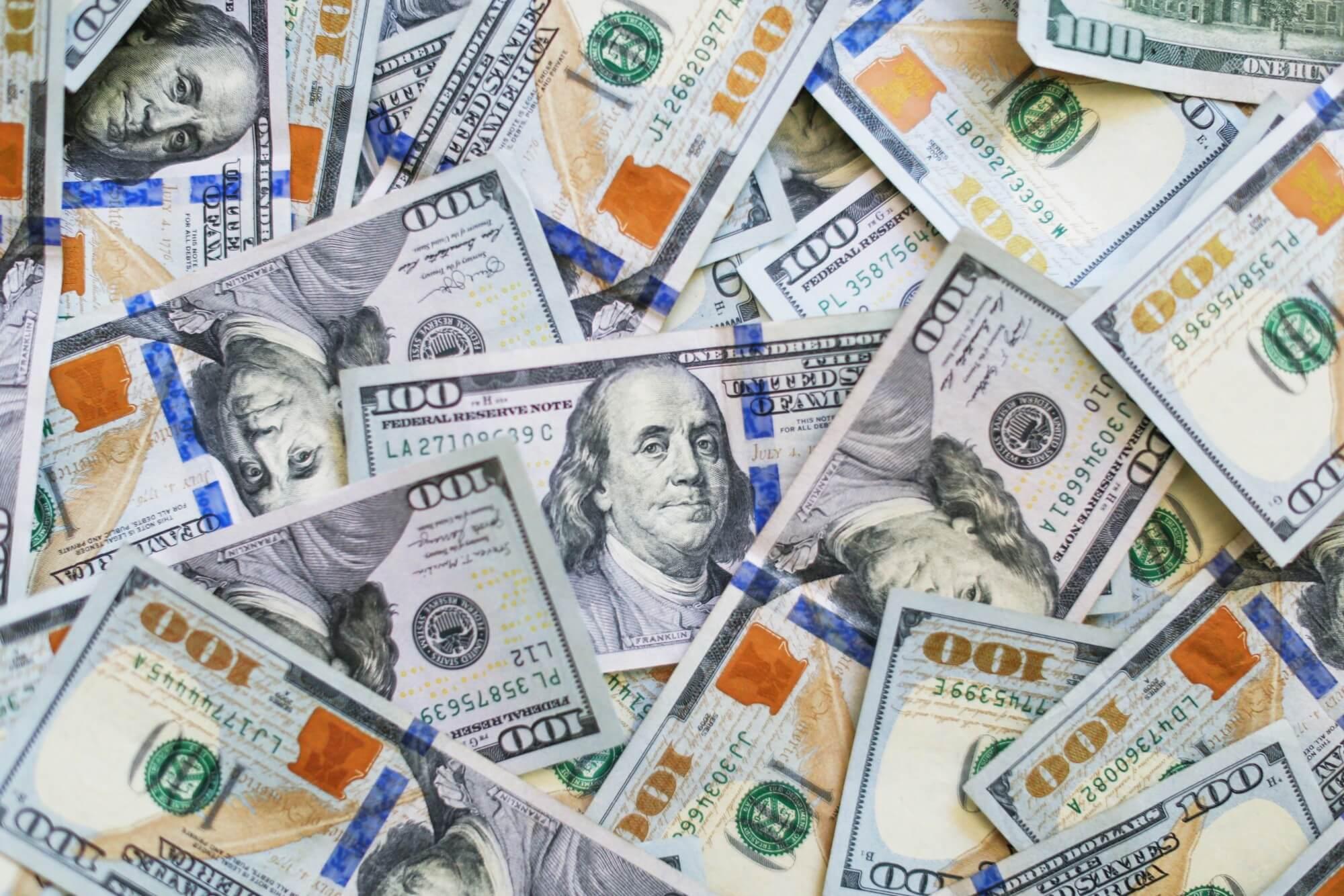 spread of one hundred dollar bills