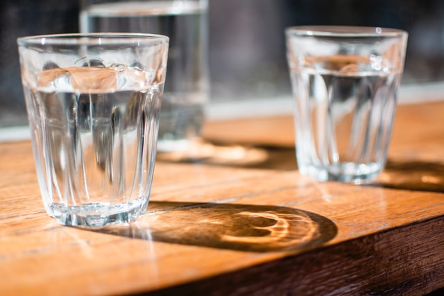 Two glasses of water sitting on table