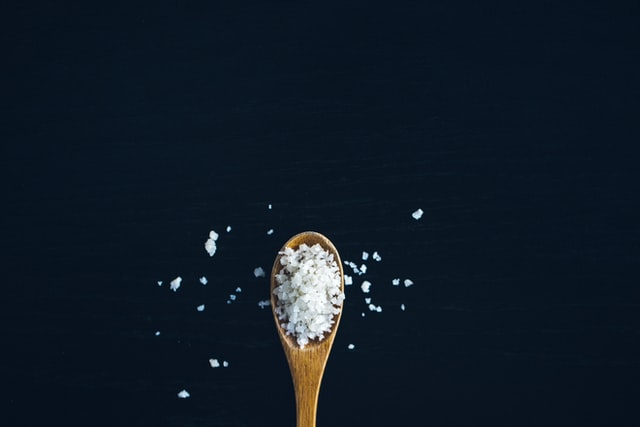 Wooden spoon with large salt granules