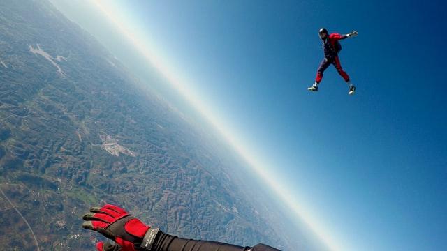 Sky divers in the sky