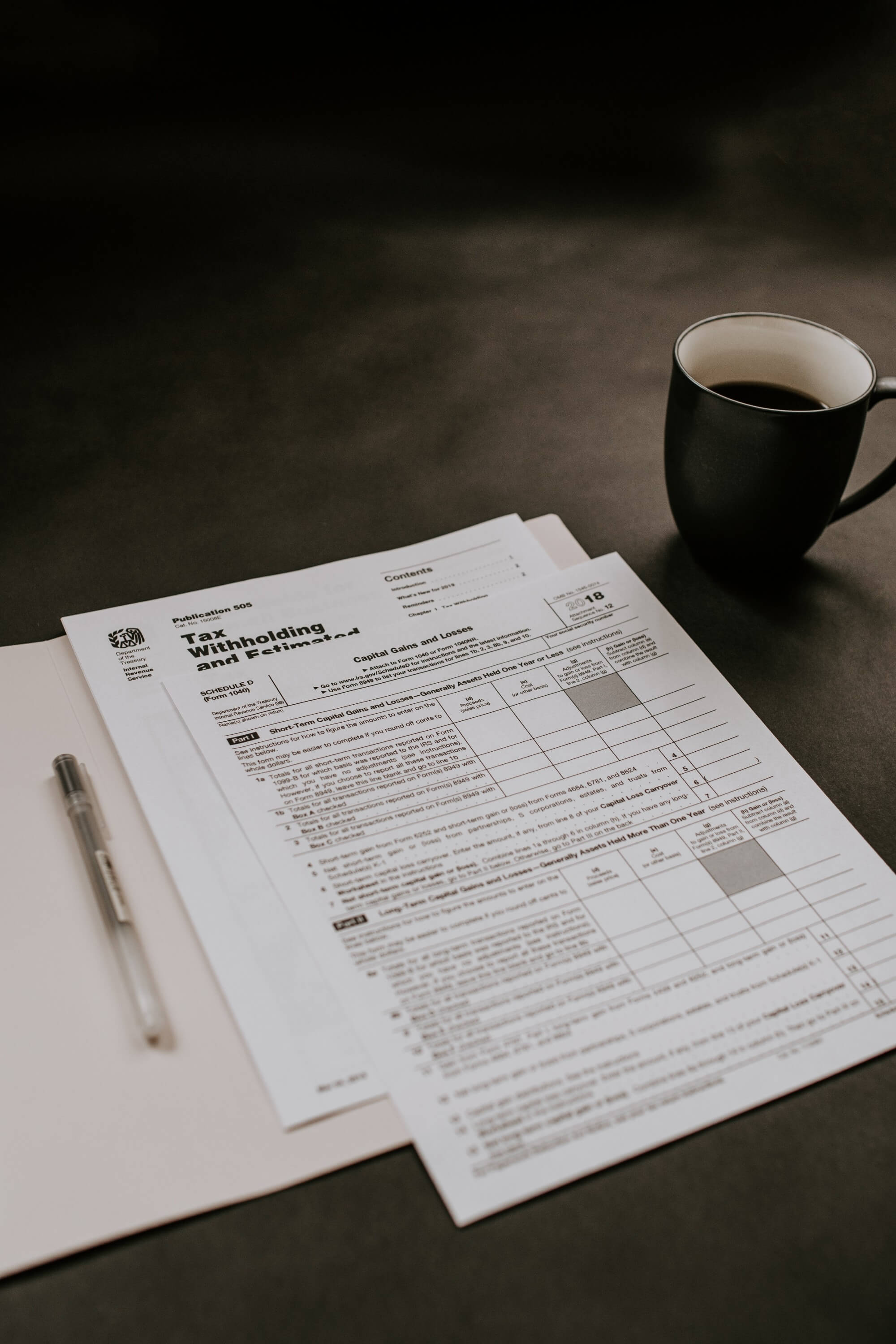 Folder with IRS forms on table