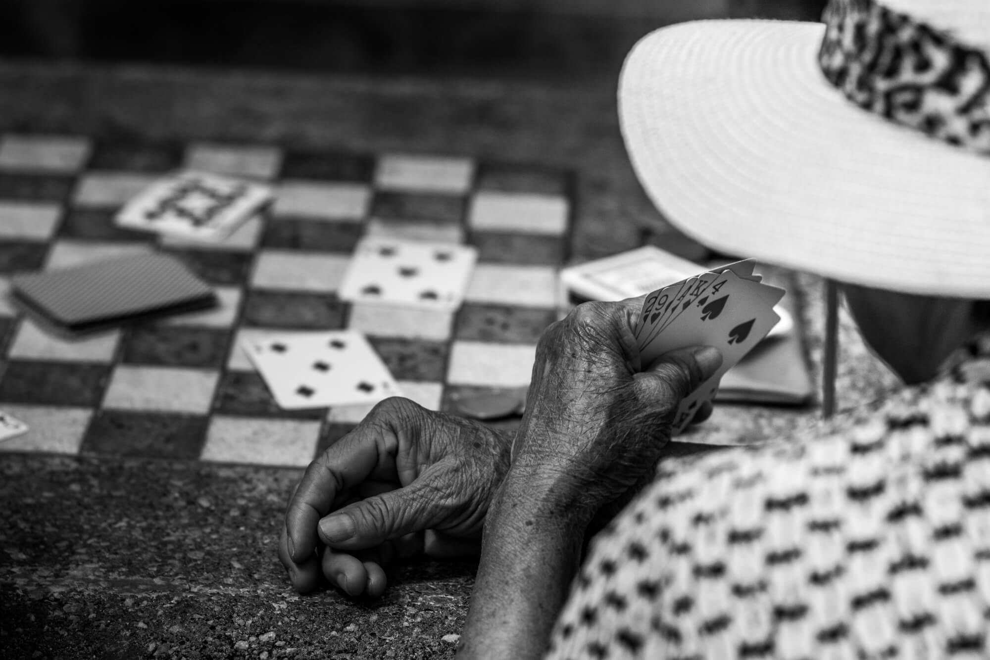 Older man playing cards