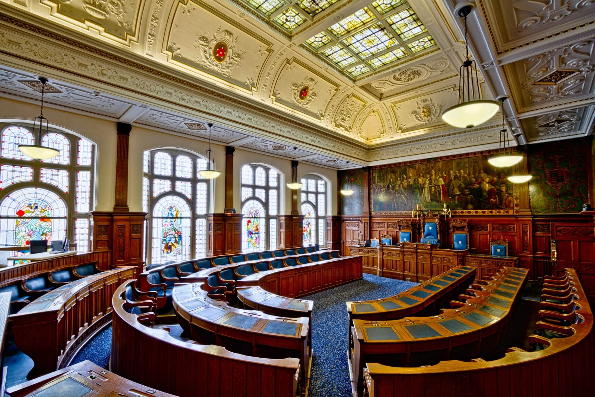 British courtroom with curved seats