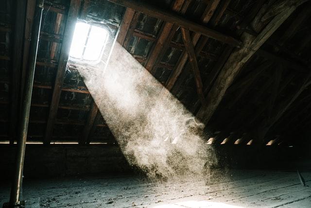 Sun coming in through dusty attic window