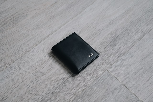 Black wallet on table