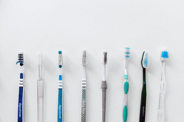 Toothbrushes lined up
