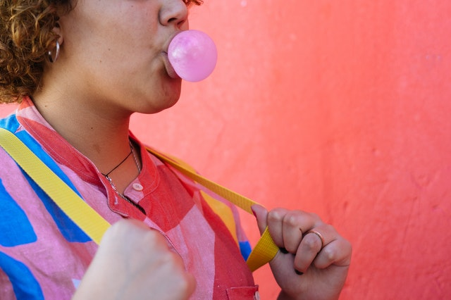 Person blowing bubble with gum