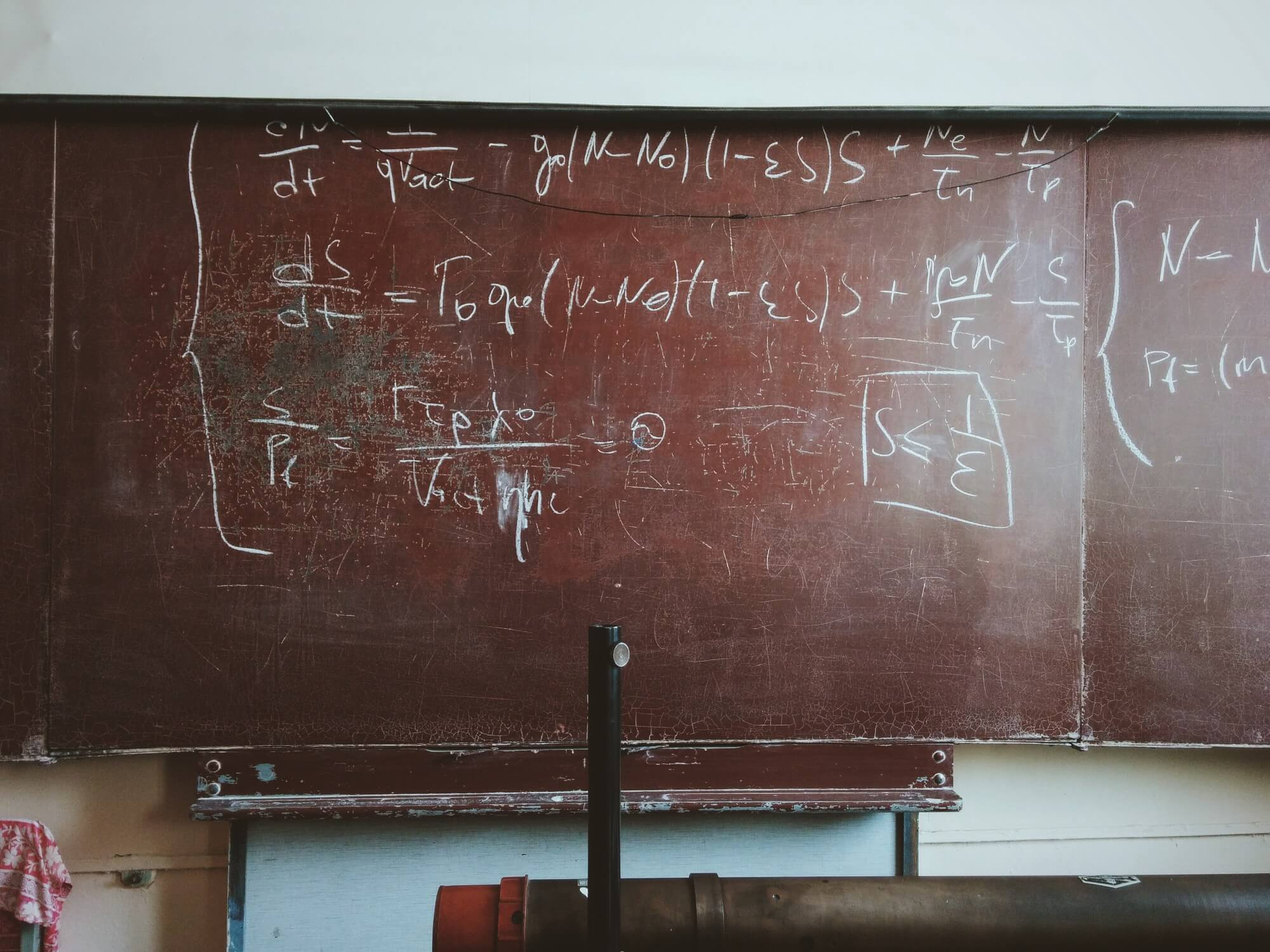 Old chalk board with scribbled math equations