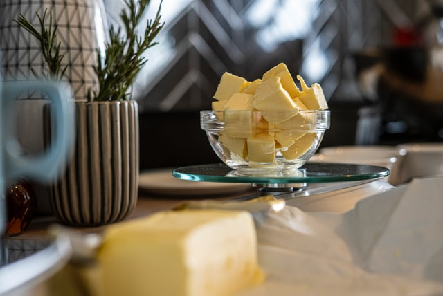 Cubes of butter in glass bowl on table