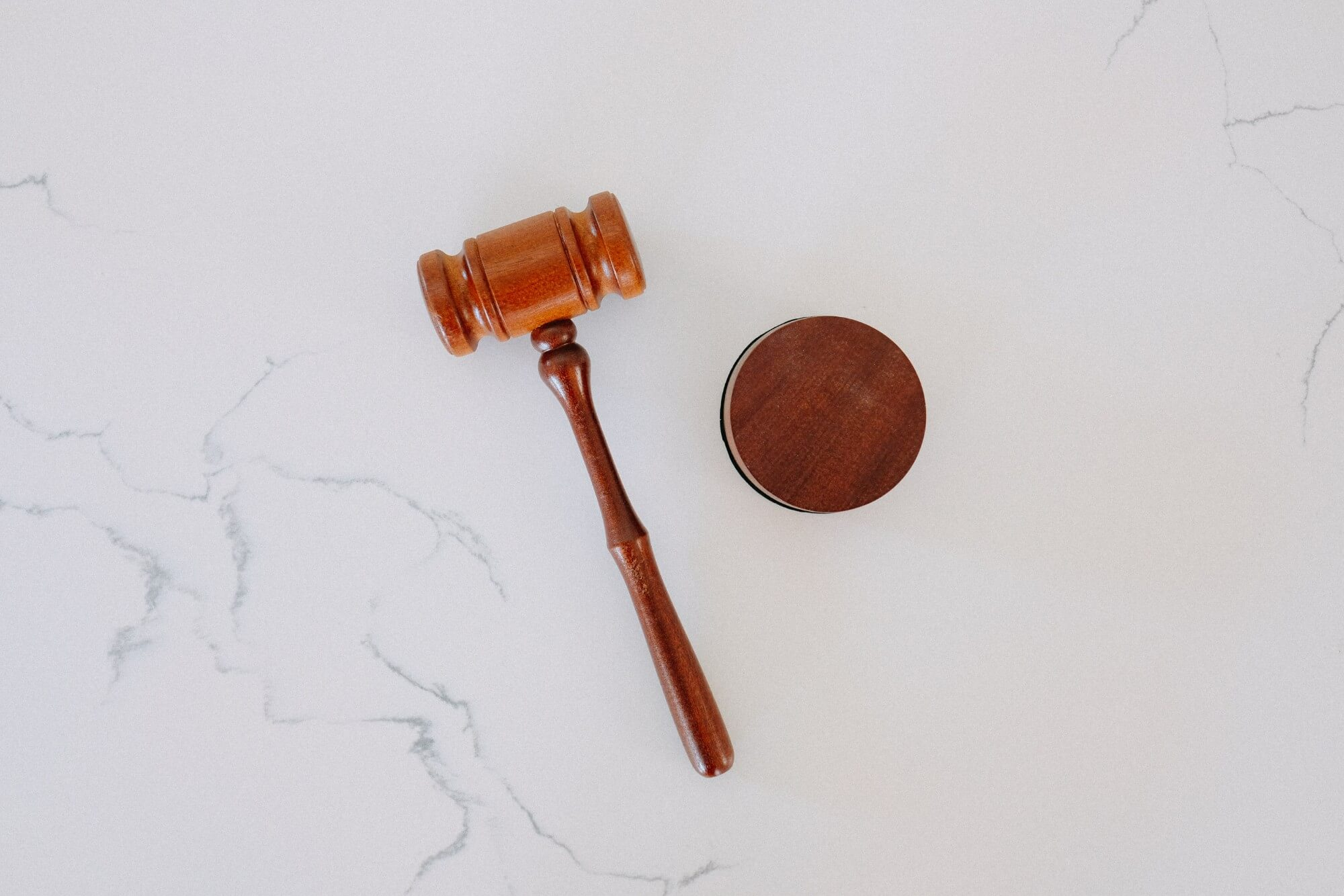 Wooden gavel on marble table top